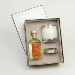 Frontgate - Antica Farmacista Orange Blossom Diffuser & Candle Set - Contains an 8 oz. diffuser, a 9 oz. round candle and a luxuriously detailed nickel-plated tray. Orange Blossom is a bright, captivating fragrance that begins with floral notes of orange blossom, lilac, and jasmine, and ends with subtle hints of vanilla musk. Diffuser arrives in an antique-inspired apothecary bottle. Insert the white birch reeds through the open neck to diffuse the scent; invert the reeds every few days or as desired to enhance the effect. Candle is produced in a clear glass vessel with a platinum leaf pattern. The Antica Farmacista Orange Blossom Diffuser and Candle Set is a beautiful collection for adding fragrance to your home. The diffuser imparts a long-lasting fragrance, making any room smell fresh and clean. The candle delivers 60 hours of scented illumination.  .  .  .  .  . Made in USA.