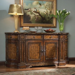Hooker Furniture Beladora Credenza - Good thing the Beladora Credenza is so big - your friends may try to take it home with them. The looks and style of a time-worn antique, and storage galore - this piece is a must have. Doors, shelves, drawers - oh my! The caramel finish with gold highlights sounds good enough to eat, but looks even better. Go ahead, show off a little bit.Not available for sale in, or delivery to, the state of California. About Hooker Furniture Corporation For 83 years, Hooker Furniture Corporation has produced high-quality, innovative home furnishings that seamlessly combine function and elegance. Today, Hooker is one of the nation's premier manufacturers and importers of furniture and seeks to enrich the lives of customers with beautiful, trouble-free home furnishings. The Martinsville, Virginia, based company specializes in lifestyle driven furnishings like entertainment centers, home office furniture, accent tables, and chairs. Construction of Hooker Furniture Hooker Furniture chooses solid woods and select wood veneers over wood frames to construct their high-quality pieces. By using wood veneer, pieces can be given a decorative look that can't be achieved with the use of solid wood alone. The veneers add beautiful accents of color and design to the pieces, and are placed over engineered wood product for strength. All Hooker wood veneers are made from renewable resources and are located primarily on the flat surfaces of the furniture, such as the case tops and sides. Each Hooker furniture piece is finished using up to 30 different steps, including 13 steps of hand-sanding and accenting. Physical distressing is done by hand. Pieces receive two to three coats of solid lacquer to make extra depth and add durability to the finish. Each case frame is assembled using strong mortise-and-tenon joints, which are then reinforced by mechanical fasteners and glue. On most designs, end panels extend to the floor to add strength and stability. Panel-style furniture features strong panel and frame construction to help avoid warping. Your Hooker furniture features finished case interiors to eliminate unsightly raw wood and to help protect items you may store inside drawers or cabinets. Drawer parts are given a urethane or lacquer finish to make smooth action and durability. All drawers use dovetails, either English or French, for years of problem-free use. Drawer bottoms are constructed from plywood and attached to the plywood drawer sides via the use of hot glue and/or wood glue blocks. Most drawers are full width, depth, and height to provide the maximum amount of storage space.