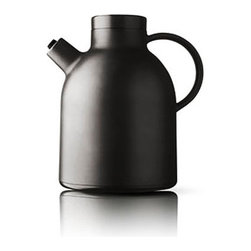 Kettle Thermo Jug by Norm Architects - MENU's Thermo Kettle Jug gets its inspiration from the classic tall cylindrical Asian teapots and the modernist teapots in glass from Bauhaus. The two typologies are merged harmoniously and given a signature Nordic touch of stylishness. The bulky handle gives a fast and secure grip and underlines the modern touch together with the exclusive stainless steel indicator that shows if the pot is open or closed.