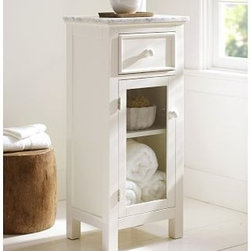 "Lucca Marble-Top Floor Storage Cabinet, White - Expand storage in a small bath with this well-designed cabinet. Crafted with a hardwood frame and a Carrara marble top, its tall, narrow shape occupies a minimum of floor space. 16.5"" wide x 12"" deep x 36"" high Crafted with a poplar wood frame. Carrara marble top. One storage drawer. Cabinet features adjustable shelf and clear tempered-glass door panel. Door is hinged on the left side"