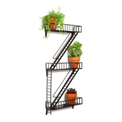 Contemporary Black Steel Shelf - While big city landlords may frown upon placing potted plants or other objects on the real deal due to fire codes (it's actually illegal in New York City), there's certainly no restriction on what you populate this clever shelving unit with: houseplants, books, candles, framed photographs and art, or tchotchkes of all shapes and sizes. Just don't expect to fit a chair or BBQ grill on the three horizontal platforms of this miniature, wall-mountable emergency exit. Bound to thrill apartment-dwelling urbanites and lovers of all things big city.
