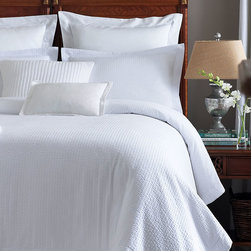 Biscayne Quilted Coverlet - Sophisticated texture and quietly comfortable quality make the Biscayne Quilted Coverlet an upscale choice for a bedroom.  Whether you prefer an energizing haven or a serene, meditative space, this seersucker spread with its dressmaker details provides a perfect fusion: clean white that's not sterile but fresh, made soft and inviting by the delicate texture.