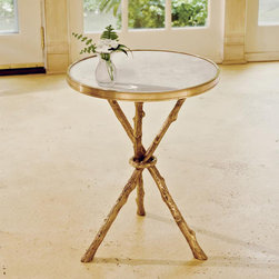 Faux Bois Drinks Table - Elements of gold and brass help a space blend eras effortlessly. I'd love to see this pretty twig table between a pair of coral armchairs.