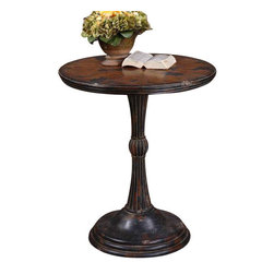 Uttermost Breton Round Accent Table - Heavily aged oak and mahogany veneers showing traces of distressed black paint with an ash gray wash to detail the hand carved pedestal. Heavily aged oak and mahogany veneers showing traces of distressed black paint with an ash gray wash to detail the hand carved pedestal.