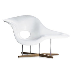 "Eames La Chaise | Danish Design Store - Charles and Ray Eames designed La Chaise in 1948 for a Museum of Modern Art competition. But it is only since 1991 that Vitra has been manufacturing small quantities of the design in serial production. La Chaise is suitable for both sitting and lying on. Its organic shape was inspired by ""Floating Figure"", a sculpture by Gaston Lachaise."