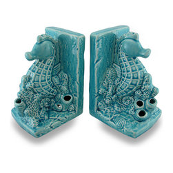 Zeckos - Ceramic Seahorse Bookends Turquoise Crackle Glaze Finish Set of 2 - Add a bit of colorful marine decor to your home, office or shop with this set of two bookends featuring a seahorse swimming in a patch of coral. With a crackled glaze finish, the tranquil turquoise color is sure to both relax you and invigorate your space Crafted from ceramic, each piece measures 7.25 inch (18 cm) high, 5 inches (13 cm) long and 4.5 inches (11 cm) wide, and has foam pads on the bottom to help prevent scratching display surfaces. This set of 2 seahorse bookends makes a wonderful gift for a friend that loves to read and for fans of nautical decor