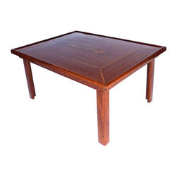 Used Chris Craft Coffee Table - A dreamboat of a table. This Chris Craft coffee table features the Chris Craft logo and rich, dark wood. Chris Craft pioneered styling and utility in boat-building and the quality shows in this table. It is the perfect table for a boat lover!
