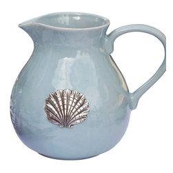 Coquille Pitcher - Mist - The detailed scallop medallion set into the wall of the Coquille Pitcher draws some of its stylization from the fan of the peacock's tail, bringing together elegant motifs for a serving vessel that looks splendid in formal interiors and well-loved vacation homes alike.  Glazed in a soft, cloudy spindrift shade, this gracefully-shaped pitcher offers a serene presence.