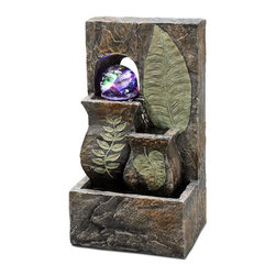 ORE International - 10.5 in. Tabletop Fountain w Embossed Leaves - Includes polished multi-tone river pebbles. Use LED light . Designed with 2 different vase size. Water cascades down front steps. With hard plastic crystal rotating ball accent. Color changes for illuminating effect. Made from polyresin. Multicolor with textured finish. 30 Days warranty. 4.75 in. L x 5 in. W x 10.5 in. H (5 lbs.)To add peace and tranquility to your home, this is the perfect item. It would go perfect on a side table as an added touch or as a centerpiece. It will surely provide a relaxing and soothing atmosphere. That is sure to create an inner harmony.
