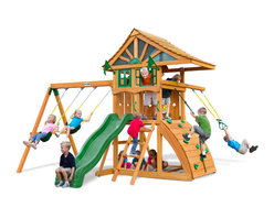 Gorilla Playsets - Ovation Swing Set - Your backyard will deserve a round of applause with the Ovation Swing Set by Gorilla Playsets. The beautiful lap style roof provides a safe haven from the sun's rays even on the hottest of days. Plus, kids love the sandbox and scaling the very cool curved rock wall - a first of its kind. The entire playset is finished in a beautiful amber stain. This premium cedar wood playset is pre-cut, pre-sanded, pre-stained and ready to assemble in your backyard over the weekend. Gorilla Playsets' cedar naturally resists rot, decay, and insect damage.