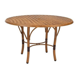 Woodard - Woodard Glade Isle Aluminum 48 Round Dining Table - The name Woodard Furniture has been synonymous with fine outdoor and patio furniture since the 1930s continuing the company�s furniture craftsmanship dating back over 140 years. Woodard began producing hand-made wrought iron furniture which led the company into cast and tubular aluminum furniture production over the years.� Most recently Woodard patio furniture launched its entry into the all-weather wicker furniture market with All Seasons which is expertly crafted and woven using synthetic wicker supported by an aluminum frame.� The company is widely known for durable beautiful designs that provide attractive and comfortable outdoor living environments.� Its hand-crafted technique used to create the intricate design patterns on its wrought iron furniture have been handed down from generation to generation -- a hallmark of quality unmatched in the furniture industry today. With deep seating slings and metal seating options in a variety of styles Woodard Furniture offers the designs you want with the quality you expect.  Woodard aluminum furniture is distinguished by the purest aluminum used in the manufacturing process resulting in an extremely strong durable product which still can be formed into flowing shapes and forms.� The company prides itself on the fusion of durability and beauty in its aluminum furniture offerings. Finishes on Woodard outdoor furniture items are attuned to traditional and modern design sensibilities. Nineteen standard frame finishes and nineteen premium finishes combined with more than 150 fabric options give consumers countless options to design their own dream outdoor space. Woodard is also the exclusive manufacturer of outdoor furnishings designed by Joe Ruggiero home decor TV personality.� The Ruggiero line includes wrought iron aluminum and all weather wicker designs possessing a modern aesthetic and fashion-forward styling inspired by traditional Woodard patio furniture designs. Rounding out Woodard�s offerings is a line of distinctive umbrellas umbrella bases and outdoor accessories.� These offerings are an integral part of creating a complete outdoor living environment and include outdoor lighting and wall mounted or free standing architectural elements � all made with Woodard�s unstinting attention to detail and all weather durability. Woodard outdoor furniture is an American company headquartered in Coppell Texas with a manufacturing facility in Owosso Michigan.� Its brands are known under the names of Woodard Woodard Landgrave and Woodard Lyon Shaw. With a variety of collections Woodard produces a wide array of collections that will be sure to suit any taste ranging from traditional to contemporary and add comfort and style to any outdoor living space. With designs materials and construction that far surpass the industry standards Woodard Patio Furniture creates beauty and durability that is unparalleled.
