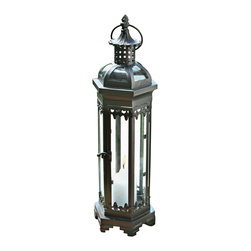 "Pier Surplus - 19.25"" Tall Metal Moroccan-style Candle Lantern #CL221889 - Add a touch of mystery and worldliness to any evening's entertainment! This metal candle lantern has been finished in dark patina and has been designed for indoor or outdoor use. Hang it outside from the top hook, or use it as a table centerpiece at a wedding. Inspired by Moroccan art, it adds a romantic, worldly touch to any special occasion. Its decorative design encases candles to burn safely."