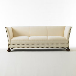 John's Sofa - If you're a fan of the graphic punctuation provided by upholstery nails, you'll love this moderne sofa from Bunny Williams.