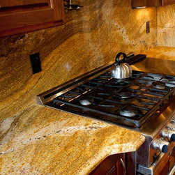 Juperana Copper Granite - Juperana Copper Granite is a Brazilian granite with a sweeping horizontal pattern that adds energy to the room. It has gold, brown, subtle green, and white minerals. It is sometimes called Golden Fantasy Granite.
