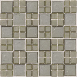 """Susan Jablon Mosaics - Transparent Sage Glass Tile - This glass tile blend is a beautiful mix of 1"""" and 2"""" grey green transparent glass mosaic tiles. It is a very sophisticated backsplash for a white, cream, gray, brown or black counter top surface. this The sage transparent 1"""" and 2"""" glass tile also offers a very relaxing soft green tone. It is a wonderful and easy to live with mosaic design. With it's rustic edges it gives a wonderfully natural, organic touch anywhere it's used.It is very easy to install as it comes by the square foot on mesh and it is very easy to clean! About a decade ago, Susan Jablon re-ignited her life-long passion for mosaics and has built a customer-focused, artist-driven, business offering you the very best in glass and decorative tiles and mosaics. We are a glass tile store committed to excellence both personally and professionally. With lines of 100% SCS Qualified recycled tile, 12 colors and 6 shapes of mirror, semi precious turquoise stones from Arizona mines, to color changing dichroic glass. Stainless steel tiles in 8mm and 4mm and 12 designs within each, and anything you can dream of. Please note that the images shown are actual photographs of the tiles however, colors may vary due to the calibration of each individual monitor. Ordering samples of the tiles to verify color is strongly recommended."""