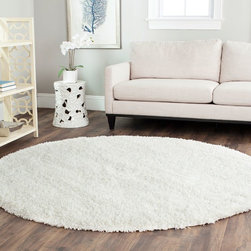 "Safavieh - Shag Shag Round 6'7"" Round White Area Rug - The Shag area rug Collection offers an affordable assortment of Shag stylings. Shag features a blend of natural White color. Hand Tufted of Acrylic the Shag Collection is an intriguing compliment to any decor."