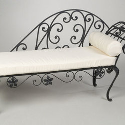 Palisades Iron Chaise - This iron chaise is a hoot. I can see Lady Chatterley reclined as we speak. I love the high iron back and side arm. What a great piece to have as a focal point on your porch or in your sunroom.
