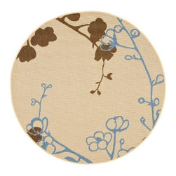 Safavieh - Indoor/Outdoor Natural/Blue Polypropylene Rug (6'7 Round) - Add some comfort to your space with this natural round indoor/outdoor rug. The rug is power-loomed and resistant to both mold and water. It is slip resistant and Its handsome blue and brown colors will never fade in the sun even after years of use.