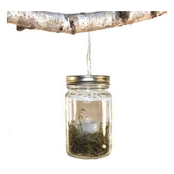 No-Flame Firefly Mason Jar - Set of 2 - The No-Flame Firefly Mason Jar is great for hanging from a tree when you're hanging around your backyard or hosting a fun neighborhood block party. Surrounded by preserved moss, its LED flameless candle puts off a warm glow without the threat of fire. Use the wire hanger to hang this rustic piece anywhere inside or out, or simply sit it on a table for hours of gentle light on a spring evening.