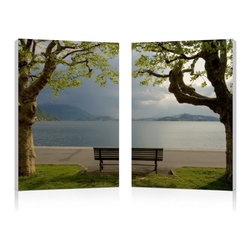 """Wholesale Interiors - Pristine View Mounted Photography Print Diptych - Neatly framed by two stately trees, a scene of still waters and majestic mountains unfolds beyond a solitary wooden park bench. This idyllic photograph is printed on waterproof vinyl canvas, adhered to two MDF wood frames, and is ready to hang in your home or office. The Pristine View Modern Wall Art Set is made in China and does not include mounting hardware. The two piece set should be wiped clean with a dry cloth. Product dimension: 15.75""""W x 1""""D x 23.62""""H."""