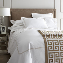 "SFERRA - King Resort Duvet Cover 106"" x 92"" - WHITE/BLACK - SFERRAKing Resort Duvet Cover 106"" x 92""Designer About Sferra:The story of Sferra begins at the turn of the 19th century when Gennaro Sferra left Italy for the United States in the hopes of finding a market among the Atlantic Coast for his intricate Venetian lace cuffs and collars. By 1912 he and his family had opened up shop on famed Fifth Avenue in New York City. A generation later Gennaro's two sons expanded their family's collection to include the most luxurious European linens of the day from renowned double damask from Ireland to Alençon laces from France to elaborate embroideries from Belgium and Switzerland. In 1977 the ownership of Sferra was sold by the family to Paul Hooker under whose keen business savvy and passionate stewardship this classic brand has flourished over the years. With the aid of great advancements in design and production techniques Sferra has secured its rightful position as a leader in the luxury linens industry. Above all the secret to the enduring reputation of the Sferra brand is the same now as it was a century ago only the finest materials are used in any product bearing the Sferra name."