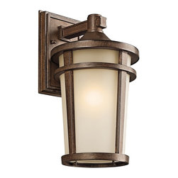 BUILDER - KICHLER 49072BST Atwood Transitional Outdoor Wall Sconce - The simple transitional style of this 1 light wall lantern from the Atwood family is perfect for today's traditional architecture. The subtle tone of the Brownstone finish and Light umber seedy glass coordinate beautifully. Everything about this tapered round lantern from its cast aluminum rings to its stepped canopy make it an ideal complement to your home. U.L listed for wet locations.
