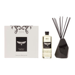 Joya - Orange Blossom and Pale Musk Diffuser Set - Pamper yourself with a beautiful smell that will last day and night. This diffuser's heavenly scent comes from the combination of orange flower water, almond oil, woodbine honeysuckle and orchid. Best of all, it comes with a butterfly-imprinted vase designed by artist Sarah Cihat.