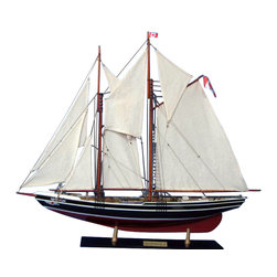 """Handcrafted Model Ships - Bluenose 2 Limited 32"""" - Wooden Sailing Yacht Model - Not a model ship kit. Attach sails and Bluenose yacht models are Ready for Immediate Display. Unmatched craftsmanship and attention to detail in this Limited Edition scale replica of the famous Canadian schooner make this model the Captain and envy of the Bluenose fleet. Commanding any room with the same winning spirit and hard-working attitude that won her decades of awards as both a racing and fishing vessel, this awe-inspiring model of the Bluenose is bedecked with museum-quality features and finely-crafted details. 50 inch L x 8 inch W x 38 inch H (1:40 scale)."""