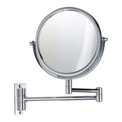"""Decor Walther - Decor Walther SPT 33 Cosmetic Mirror - The SPT 33 Cosmetic Mirror  has been designed and made by Decor Walther.  TSPT 33 wall-shaving mirror, on this wall-mounted mirror may be  plucked, for the German manufacturer Decor Walther, The wall mirror in  heavy quality from high-gloss chrome-palted brass. And since Maiken  Walther included so many narcissistic side of a human being in the  bathroom with their design, the small mirror is exceptionally versatile  suspended Swiveling in his frame, loads of mirror will to use its  double-sided mirror surface: simple or 5-flod magnification. It can also  be used on the horizontally mounted arm round the SPT 33 wall-shaving  mirror as closely as possible ( with radius wall mount mirror 46 cm).  Product Details:  The SPT 33 Cosmetic Mirror  has been designed and made by Decor Walther.  TSPT 33 wall-shaving mirror, on this wall-mounted mirror may be plucked, for the German manufacturer Decor Walther, The wall mirror in heavy quality from high-gloss chrome-palted brass. And since Maiken Walther included so many narcissistic side of a human being in the bathroom with their design, the small mirror is exceptionally versatile suspended Swiveling in his frame, loads of mirror will to use its double-sided mirror surface: simple or 5-flod magnification. It can also be used on the horizontally mounted arm round the SPT 33 wall-shaving mirror as closely as possible ( with radius wall mount mirror 46 cm).  Details:                                      Manufacturer:                                      Decor Walther                                                                  Designer:                                     In House Design                                                                  Made in:                                     Germany                                                                  Dimensions:                                      Diameter: 7.48"""" (19 cm) X Depth: 18.11"""" (46 cm) X Height:"""