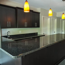 Contemporary Kitchen by Summit Signature Homes, Inc.