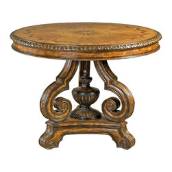 Ambella Home - Algiers Center Table - This unique and unusual table will be a stunning addition in your foyer with a huge bouquet of fresh flowers sitting on top. The intricate, inlaid top has a walnut and oak burl veneer and mahogany finish. The ornately scrolled base has a wink to Aladdin and his lamp tucked into the center.