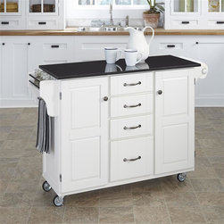 HomeStyles - 48 in. Wood Kitchen Cart - With a touch of modern styling, this mobile kitchen cart features a shiny, black granite top with an easy to clean surface. It has a unique, side spice rack for added convenience during food prep in your kitchen. * Black granite top. Solid wood construction. Four easy open utility drawers. Two cabinet doors open to storage with adjustable shelf inside. Handy spice rack with a towel bar. Paper towel holder on other side. Heavy duty locking rubber casters for easy mobility and safety. Clear coat finish helps to protect against wear from normal use. Made from Asian hardwood. White finish. 48 in. L x 17.75 in. W x 35.5 in. H. Top Assembly Instruction
