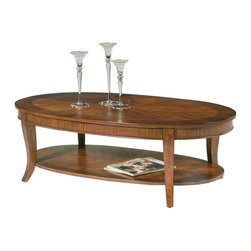 Liberty Furniture - Bradshaw Oval Cocktail Table - Ornate veneering design. Flared legs. 8-way matched veneer and walnut edge. Veneered bottom shelf. Warranty: One year. Made from select hardwoods, cherry and walnut veneers. Multi-step hand applied rich cherry finish. 48 in. W x 28 in. D x 19 in. H (51 lbs.)