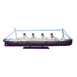 Handcrafted Nautical Decor - Remote Control RMS Titanic 72'' Limited w/LED Lights - REMOTE CONTROLLED VERSION--SOLD FULLY ASSEMBLED--Ready for Immediate Display - Not a Model Ship kit--Unmatched in elegance, detailing or craftsmanship, these opulent Limited Edition scale model RMS Titanic replicas are the museum-quality crown jewel of our fleet of RMS Titanic models. Enjoy the exquisitely crafted and delicate features abounding upon her decks, the grace and majesty of her carefully rendered lines, and the attention to every detail of this superlative model of history's most famous ocean liner. Be swept away by the magnificent splendor and timeless allure of these RMS Titanic replicas.--72'' Long x 10'' Wide x 24'' High (1:212 scale)----    Wireless Controller included--    Built from      scratch by      master artisans--    High quality      woods include      cherry, birch, maple and rosewood--    Museum Quality features not available in other models or any kit--    --        Paint colors precisely matched       to those of the RMS Titanic ships--        All windows and portholes       exactly sized and positioned according to the original RMS Titanic construction plans--        Historical design and       detailing of superstructure and hull--        Open promenade decks visible through superstructure windows--        Precise superstructure design and detailing--        Triple propeller design and       accurate anchors--        Metal trussed crane booms with       twin cables and pulleys on cargo hooks--        Detailed, separate lattice       grates on all ducts and vents--        Metal slat deck benches rather       than solid carved wood--        Finely-crafted wire       maintenance ladders ascend smokestacks--    --    --    Meticulous      painting to      accurately match the actual RMS Titanic      --    Amazing Details, including:--    --        Lifeboats hung from launching davits--        Rigging and stay-lines on all       masts and smokestacks--    