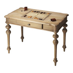 Butler Specialty - Butler Game Table - This table features a reversible game board meticulously crafted in alternating maple and walnut veneers with a chess/checker board on one side and a backgammon board on the other, plus a large drawer for storing game pieces. exquisitely turned tapered legs and ballerina feet underscore the quality of the design and craftsmanship. The table is made from Mindy wood solids in the Urban Gray finish. Game pieces may be purchased separately.
