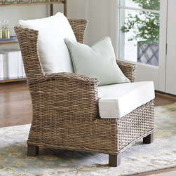 Ballard Designs - Sloane Wingback Chair - Adds a casual note to any setting. Hatrdwood feet with driftwood finish. Includes off-white cotton canvas back & seat cushions. This casual take on the classic wingback chair is so comfortable, it will soon be your favorite spot to get away from it all. Perfectly scaled to fit anywhere from the bedroom to the sunroom, it's hand woven of natural rattan and finished in warm driftwood gray. Sloane Wingback Chair features:. . .
