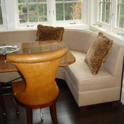 Booths and Banquettes - We fabricated all of the upholstery in this picture. The banquette curves around a corner and ties in to a wall not picture. There was a set of (2) chairs, one of which you see pictured here, that also had a nail trim. The booth had a base that was revealed and finished and set on legs.