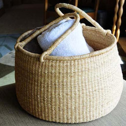 Accra Storage Basket - This basket would make any space look inviting. I love the flexible handles and the organic shape.