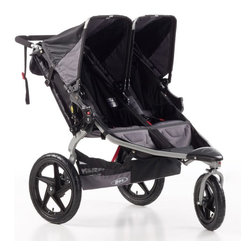B.O.B. - B.O.B. Revolution SE Double Stroller - Duallie-Black - ST1043 - Shop for Jogging Strollers from Hayneedle.com! Who needs a running partner to keep you company out on the trail when you can bring two of your favorite people with you in the B.O.B. Revolution SE Double Stroller - Duallie-Black? There's no better way to establish a lasting bond with your children than by being a positive influence for them as you head outdoors for some fresh air and exercise while simultaneously interacting and keeping a close eye on them through the large viewing windows. And these running buddies won't slow you down. With the front wheel locked this double stroller has the forward-focused stability necessary to be used as a speedy jogging stroller. Coil spring and elastomer core shock absorbers provide three inches of wheel travel and the adjustable release knobs ensure that your stroller will have just the right suspension as your children grow. The adjustable canopies also keep your little ones shielded from the elements so you don't have to worry about their comfort or safety while you're out on the trail. When you're not out on the trail there's no need to invest extra money in multiple strollers. Simply unlock the front swivel wheel and this stroller gains all the maneuverability you'd look for in a walking stroller allowing you to weave through store aisles or crowds of people while keeping your children safe and close by. Plus its durable and lightweight frame simple two-step folding and compact design make it easy to stow and go. Out on the trail or running around town using the Resolution SE - Duallie will show your children what it means to be a smart and close family. Additional features: Front wheel swiveling capability for tighter turns Front wheel locking mechanism for active performance State-of-the-art adjustable coil suspension system Easy two-step folding Padded handlebar and wrist strap for sure grip Ultra-padded seats for greater comfort Individually adjus