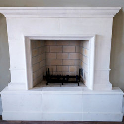 The Greenwich Fireplace - This limestone fireplace can be ordered and customized with DeSantana Stone Co. Our team of design professionals is available to answer any questions you may have at: (828) 681-5111.