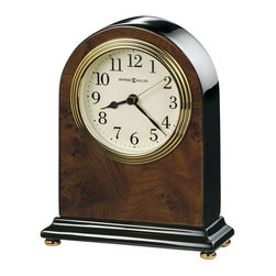 HOWARD MILLER - Bedford Table Clock with Walnut Piano Finish - An attractive high-gloss walnut piano finish on a hardwood arch table clock featuring a wood burl pattern on the front and back, with black sides and base.