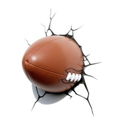 3D Wall Art Nightlight, Football - Even a football hero needs a nightlight sometimes. This tough-looking ball is made to look powerful enough to crack through a wall, but it provides a nice, gentle glow in the darkness.