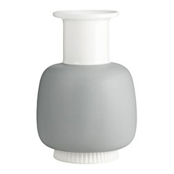 Normann Copenhagen - Nyhavn Vase Large by Normann Copenhagen - The Normann Copenhagen Nyhavn Vase Large is both named after and inspired by the homes of the historic Nyhavn waterfront district in Copenhagen. As such, it is made out of a dusty Mineral Grey porcelain and comes in a height and width that will contrast with other pieces in the Nyhavn collection. Normann Copenhagen is a Danish designer and manufacturer of high-quality modern home accessories, kitchen tools, glassware, tableware, furniture, lighting and more. Guided by the basic tenets of Scandivanian design, Normann Copenhagen offers a large array of products that feature a minimum of superfluous lines and regular use of natural materials. These pieces are further distinguished by modern bursts of color and functionality that is at once fresh and unique, yet uncomplicated and accessible.