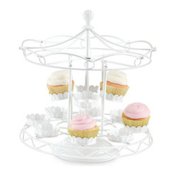 Horchow - Carousel Cupcake Holder - This merry-go-round brings out the kid in me. I find it so whimsical and think guests would love to grab a cupcake from it.