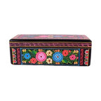 """Used Hand-painted Olinala Black Wooden Box with Flowers - This folk art form incorporates elements of pre-Hispanic, European and Chinese traditions which came together in colonial Mexico and continue to develop today. First the wood or gourd surface is coated with a mixture of chÃ_a seed oil, made from the seeds of the Salvia plant, and aje, a waxy fat from an insect. Then a layer of earth is placed on top to absorb the oil. This """"earth varnishâ€ù or lacquer is smoothed out and polished with a stone and the heel of the hand. This process may be repeated a number of times. Pigments can be added to create the background color. Recently, artists have begun to mix the background color in with the oil and have applied it with a brush. After it is dried, which may take several days, the decoration is applied."""