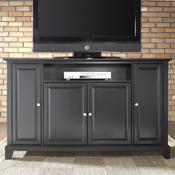 """Crosley - Newport 60"""" TV Stand - Enhance your living space with one of Crosley's impeccably-crafted TV stands. This signature cabinet accommodates most 60'' flat panel TVs and is handsomely proportioned featuring character-rich details sure to impress. Raised panel doors strategically conceal stacks of CDs/DVDs, gaming components and various media paraphernalia. Open storage area generously houses media players and the like. Adjustable shelving offers an abundance of versatility to effortlessly organize by design, while cord management systems tame the unsightly mess of tangled wires. Customize our distinct cabinets by selecting one of four collection styles (featuring tapered, traditional. turned or bun feet) in your choice of one of three signature Crosley finishes. This customizable cabinet approach is designed for easy assembly, built to ship and constructed to last. Features: -Raised panel doors.-Five adjustable shelves for storing electronic components, gaming consoles, DVDs and other items.-Adjustable levelers in legs.-Recommended TV Type: Flat screen.-TV Size Accommodated: 60"""".-Powder Coated Finish: No.-Gloss Finish: No.-Material: Hardwood and veneers.-Solid Wood Construction: No.-Distressed: No.-Exterior Shelves: Yes -Number of Exterior Shelves: 1.-Adjustable Exterior Shelves: No..-Drawers: No .-Cabinets: Yes -Number of Cabinets: 3.-Number of Doors: 4.-Door Attachment Detail: Pin hinge.-Interchangeable Panels: No.-Magnetic Door Catches: Yes.-Cabinet Handle Design: Knob.-Number of Interior Shelves: 5.-Adjustable Interior Shelves: Yes..-Scratch Resistant : No.-Removable Back Panel: No.-Hardware Finish (Finish: Black): Brushed nickel knobs, steel hardware.-Hardware Finish (Finish: Classic Cherry, Vintage Mahogany): Antique brass knobs, steel hardware.-Casters: No .-Accommodates Fireplace: No.-Fireplace Included: No .-Lighted: No .-Media Player Storage: Yes.-Media Storage: No .-Cable Management: Hole in back for wires.-Remote Control Included: No.-Batteries Req"""