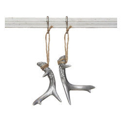 Deer Antler Ornament in Silver - Bringing the ski lodge look into a modern home doesn't have to mean sweeping additions. Sometimes, the transformation happens in the details. Hang this resin deer antler on your tree this season for a touch of elegance and invite the rustic character of the mountains into your home.