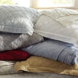 Diamond Linen Quilt and Shams - I'd be happy to spend any fall morning cuddled up under this diamond quilt from Pottery Barn. Sold in many beautiful colors, including the quintessential fall colors like burgundy and gold, these lovely linens would complement any bed.