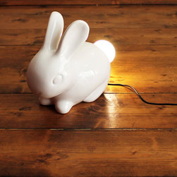 Bunny Lamp - Super adorable bunny with a light-bulb where his fluffy tail should be. We don't have to explain any more than that, he's irresistible, and a little surreal. Face in different directions to adjust the amount of light directed into a dark room. The light stays cool to the touch and is made up of energy efficient LEDs. Powered via USB, so it will work with your existing phone or camera charger plug. We also include a UK mains USB adaptor in the box