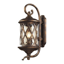 """Elk - Barrington Gate 28"""" High Outdoor Wall Light - Dress up garage areas porches and more with this handsome outdoor wall light design from Elk Lighting. Part of the Barrington Gate collection the design features an oval wall plate and hammered clear glass panels for an antique look. A hazelnut bronze finish adds to the rich visual appeal. Takes three 60 watt candelabra bulbs (not included). 28"""" high. 11"""" wide. Extends 15"""" from the wall.  Hazelnut bronze finish.  Clear hammered glass.   Takes three 60 watt candelabra bulbs (not included).   28"""" high.   11"""" wide.   Extends 15"""" from the wall."""